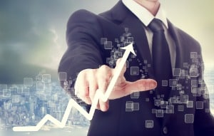 Businessman Touching a Chart Indicating Growth